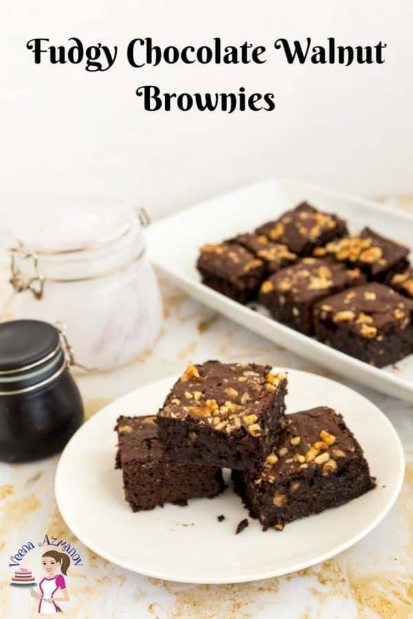 Three chocolate brownies on a plate.