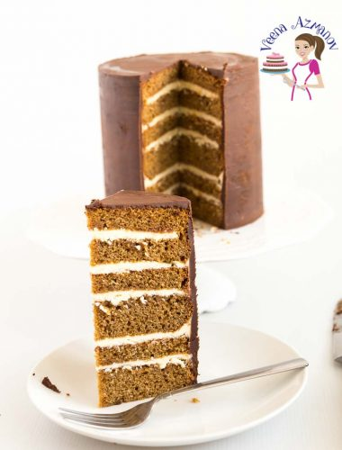 A slice of layer gingerbread cake on a plate.