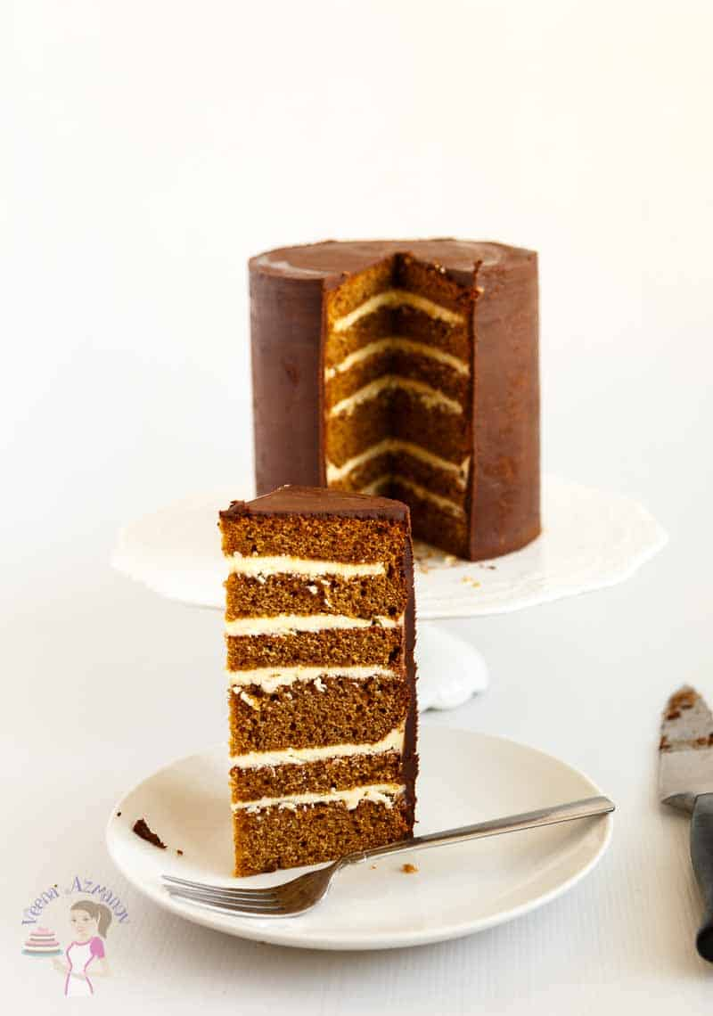 A slice of gingerbread layer cake on a plate.