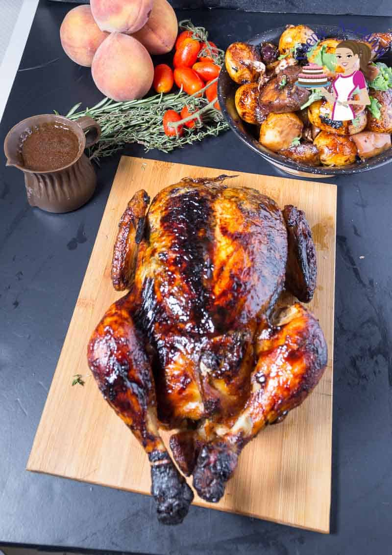A whole roasted chicken on a cutting board.