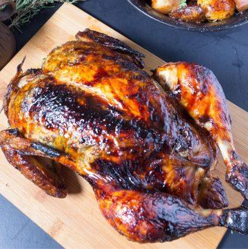 A roast chicken on a board