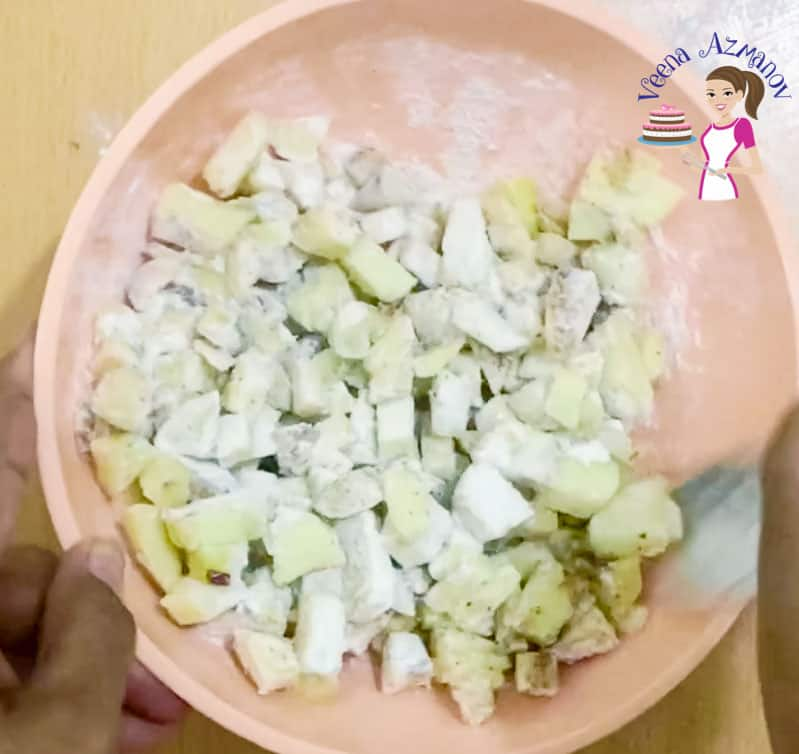 A bowl of diced apples and flour.