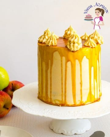 A frosted cake with caramel sauce