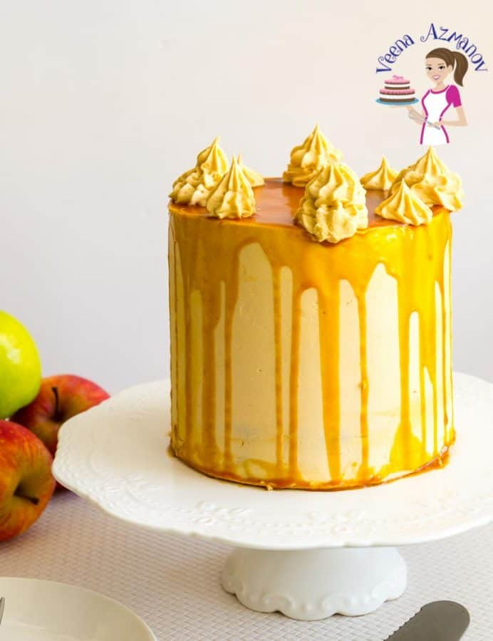 A caramel apple cake with caramel buttercream on a stand.