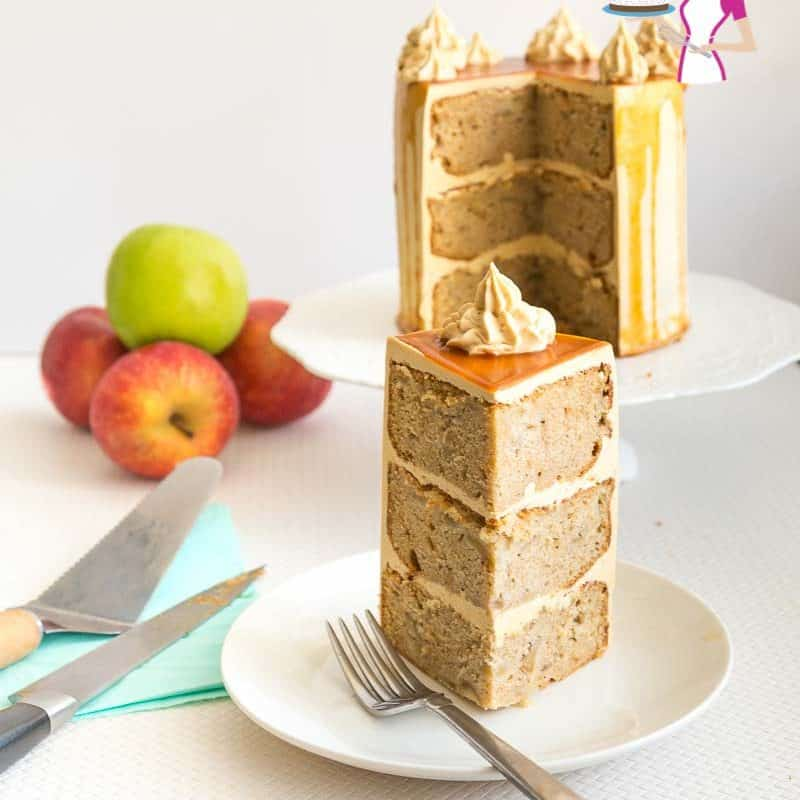 A slice of caramel apple cake with caramel buttercream on a plate.