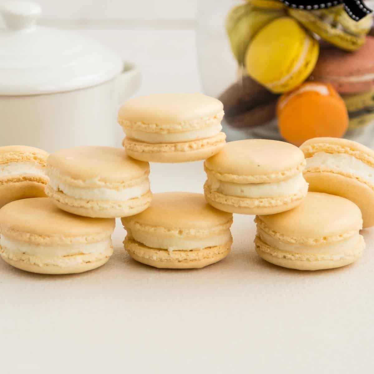 A stack of macarons on the white table