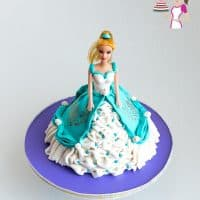 A princess cake on a stand.