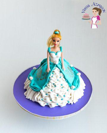 A princess cake on a stand.