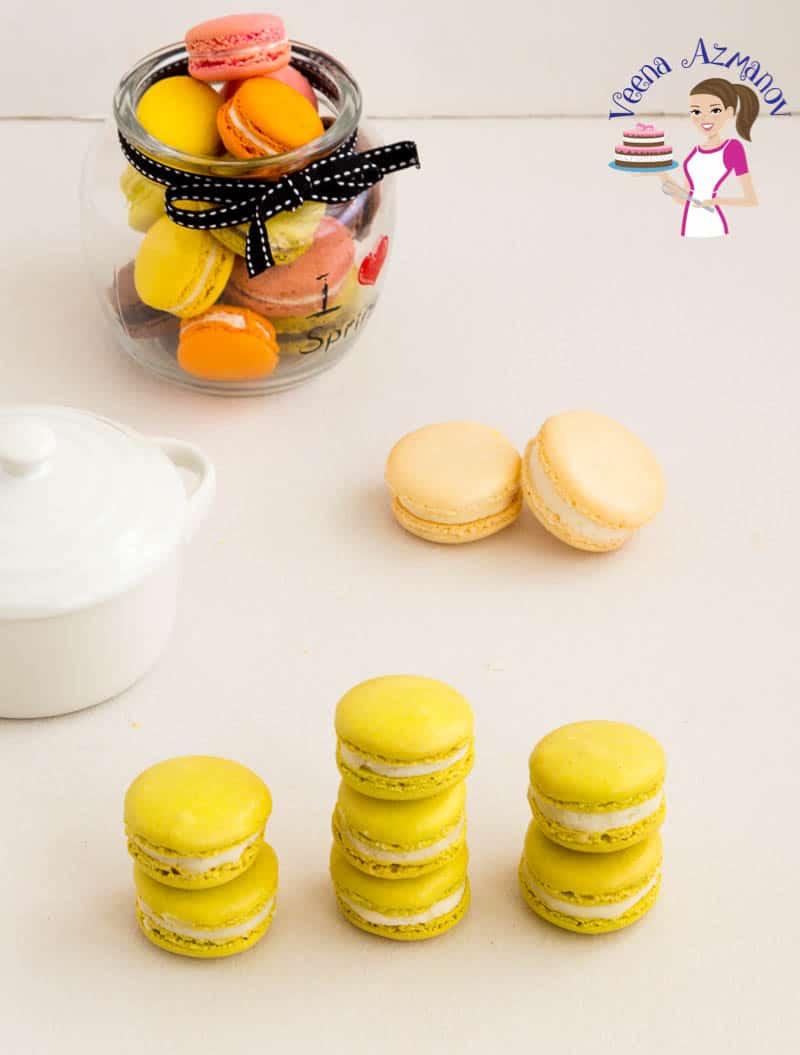 Stacks of matcha macarons on a table.