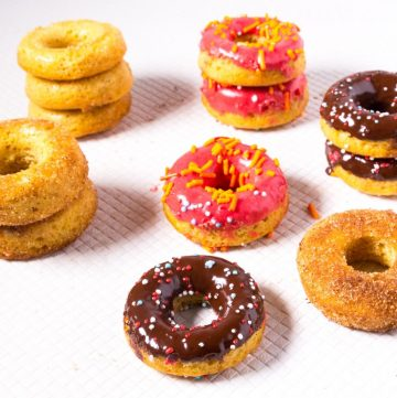 Assorted doughnuts on a table.