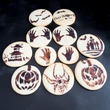 Stenciled cookies on a board.