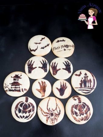 An image optimized for social media share for these fun Stenciled Halloween sugar cookies with cocoa paste.
