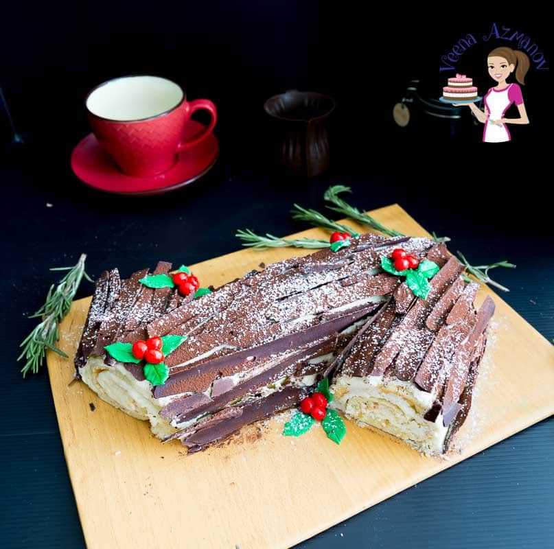A log-shaped Christmas cake on a board.