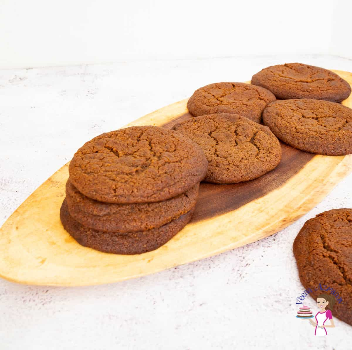 Stack of cookies on a wooden baord.