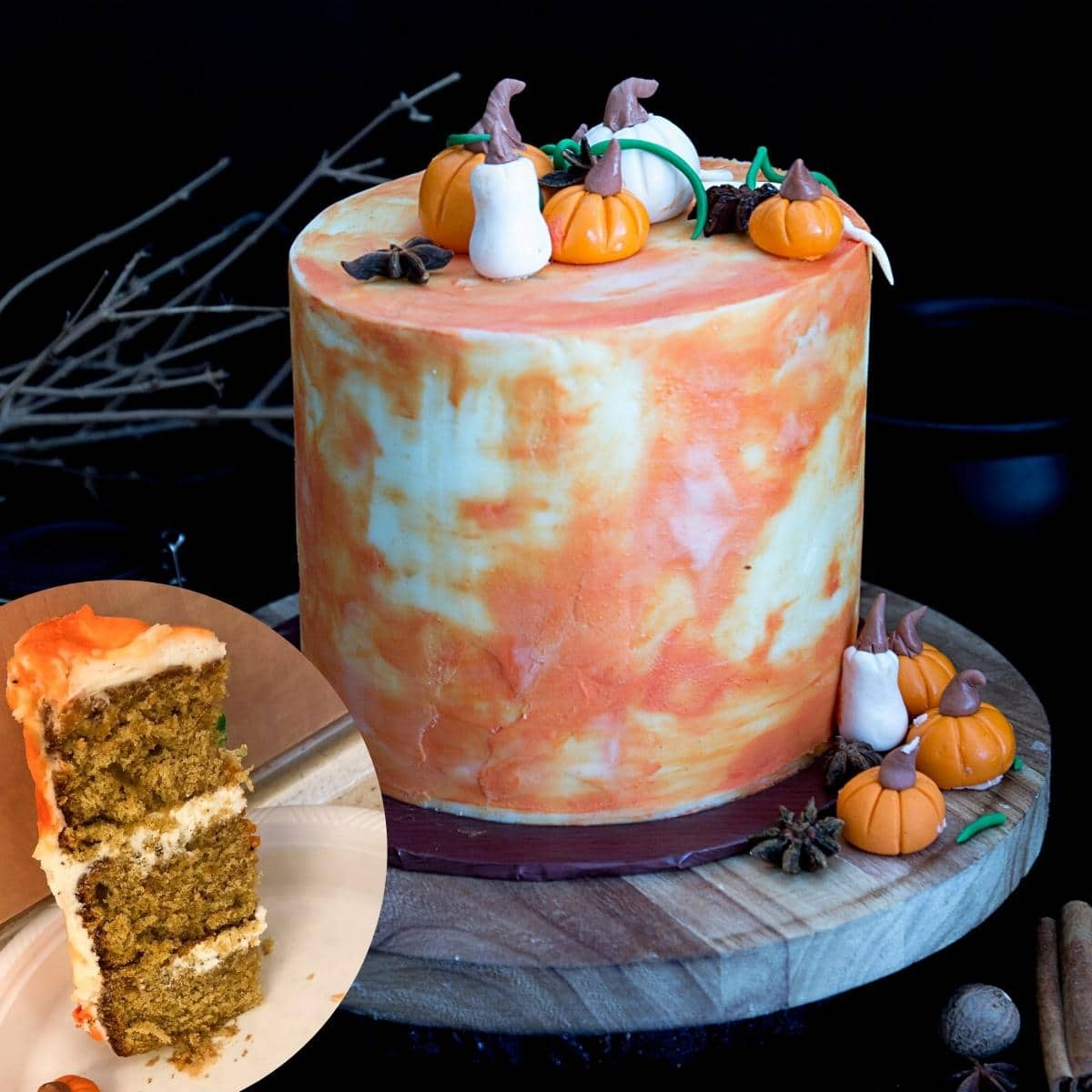 A frosted pumpkin cake with fondant pumpkins.