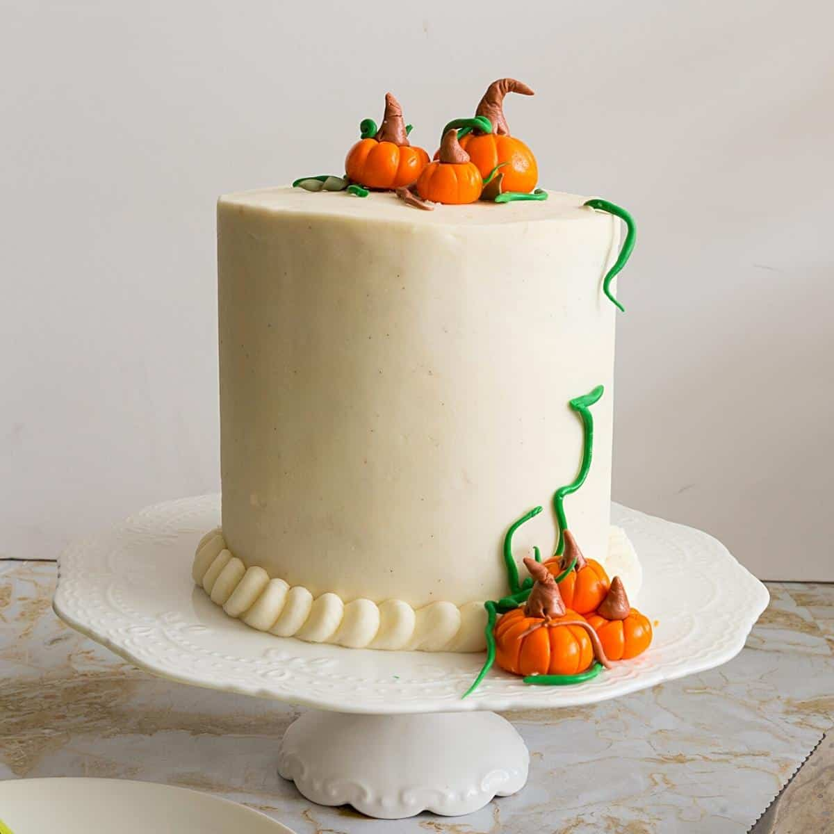 A cream cheese frosted pumpkin cake.