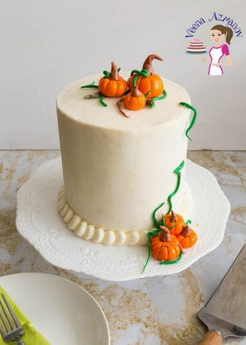 Celebrate Thanksgiving this fall with a pumpkin spice cake with cream cheese frosting topped with fondant pumpkins