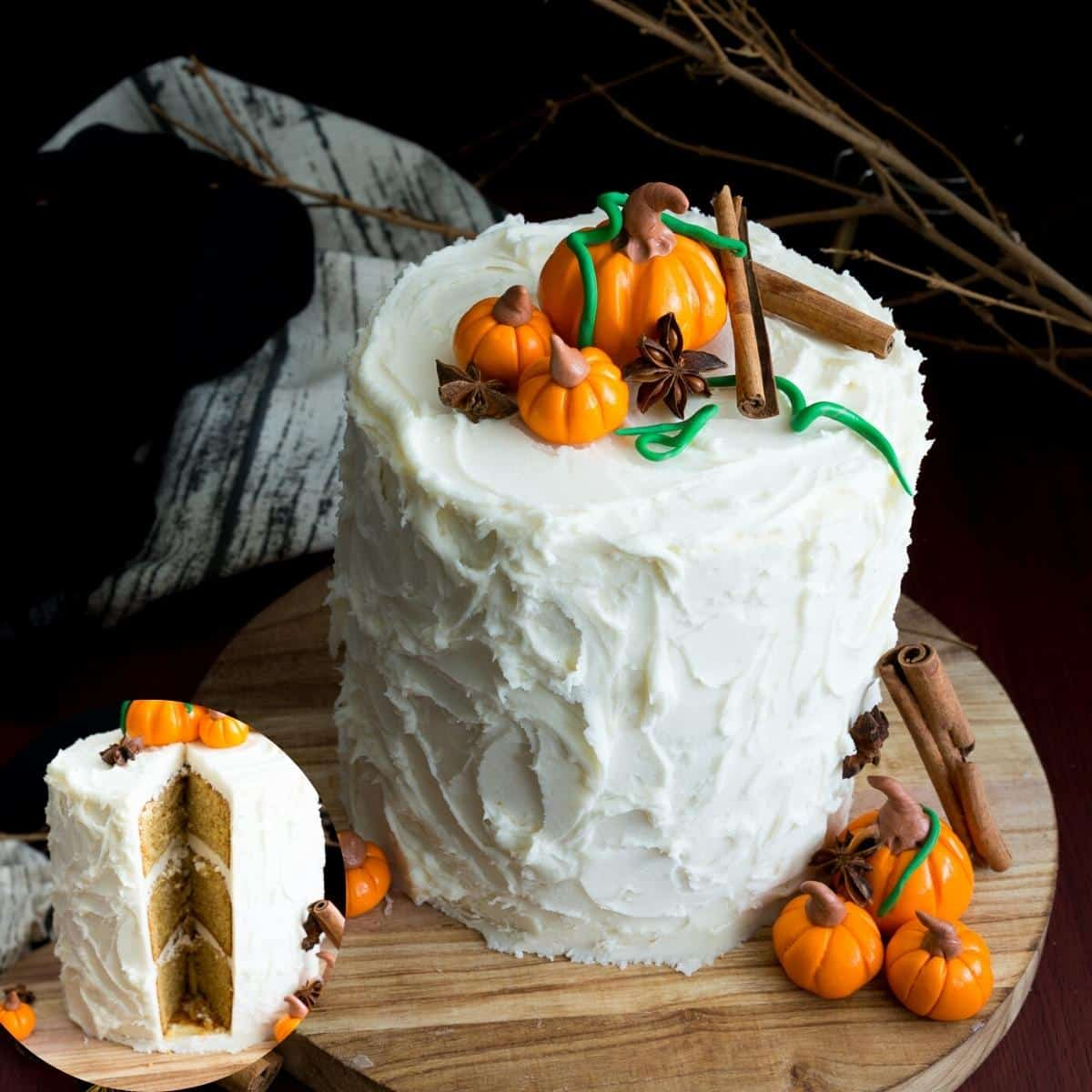 Frosted white cake with fondant pumpkins on top