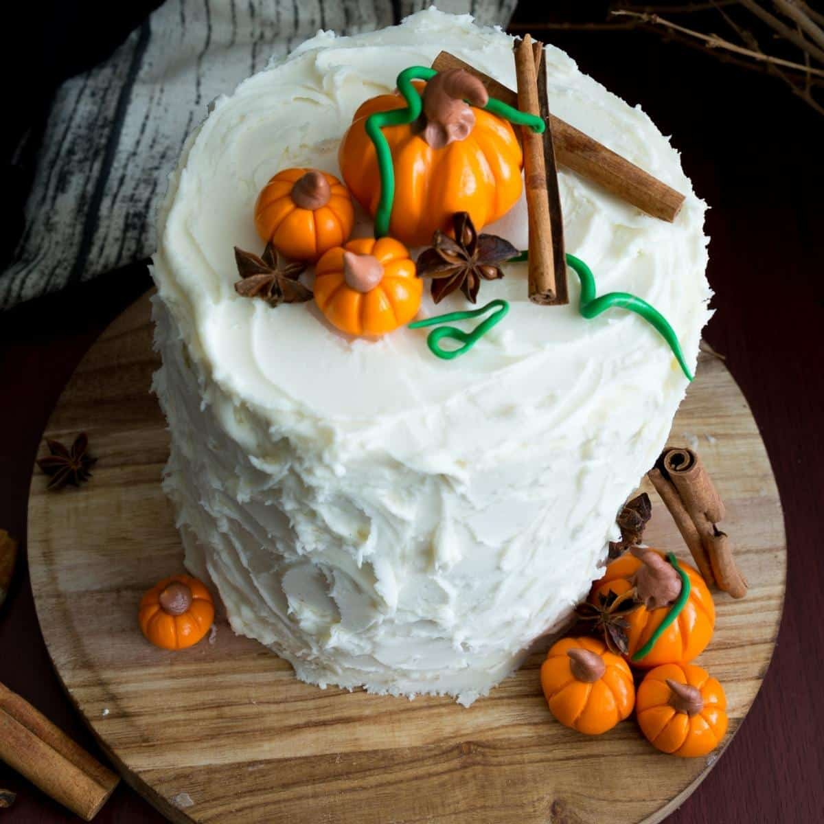 A frosted spice latte cake with fondant pumpkins.