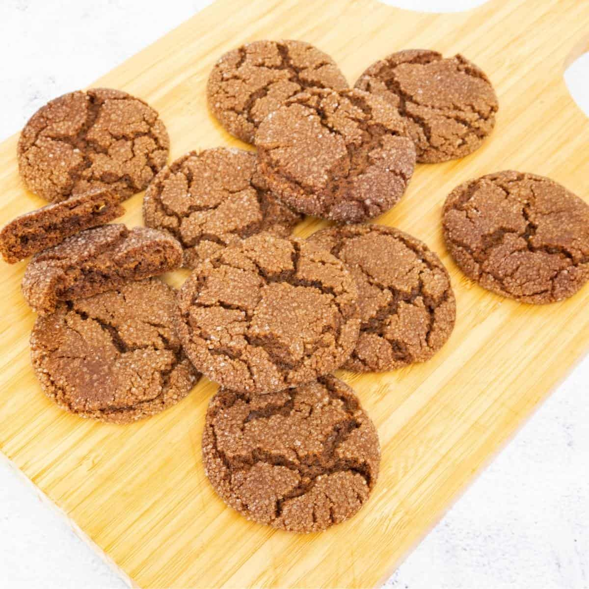 A few cookies on display on a wooden board.