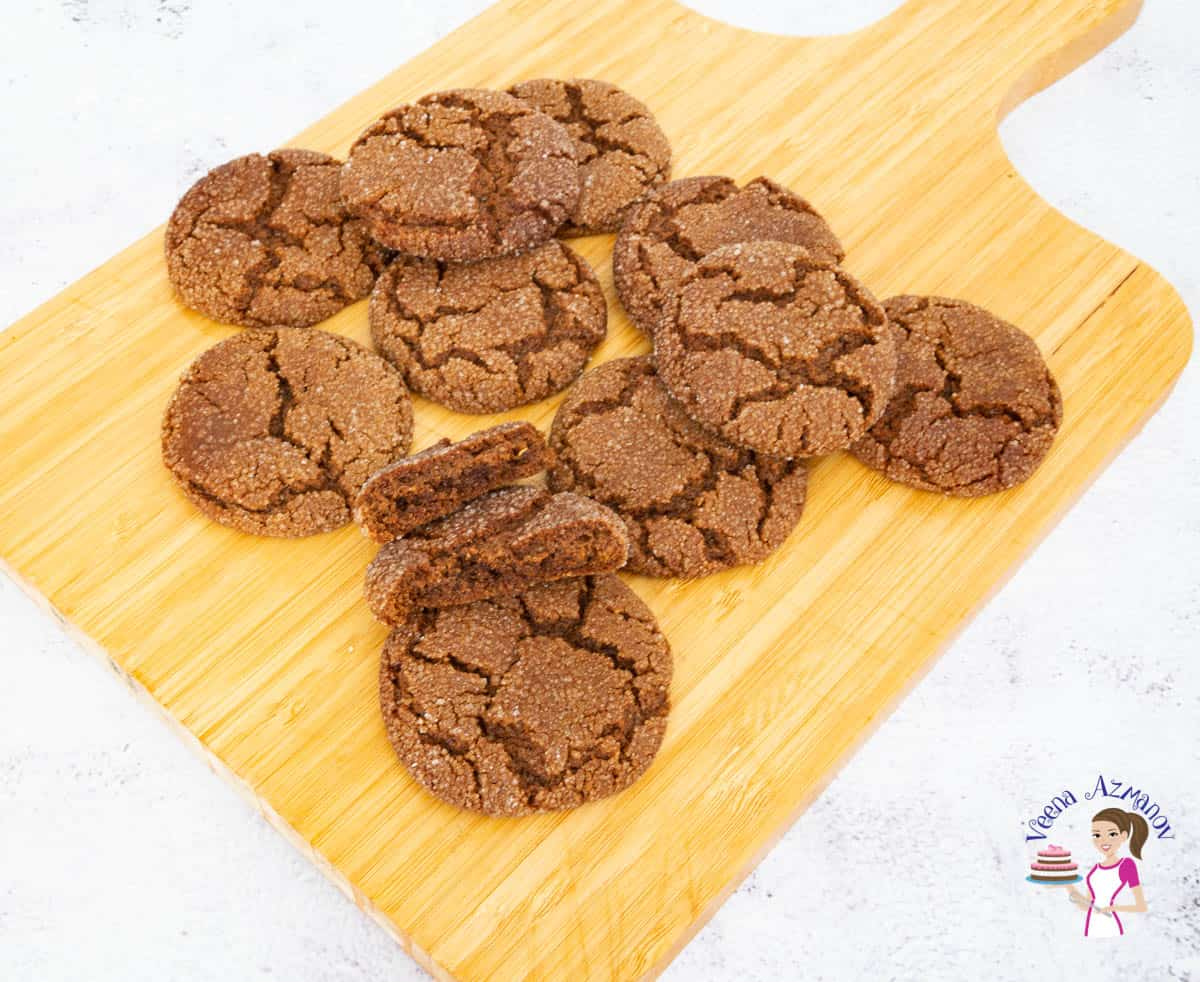 Cookies on a wooden board with one showing the soft center.