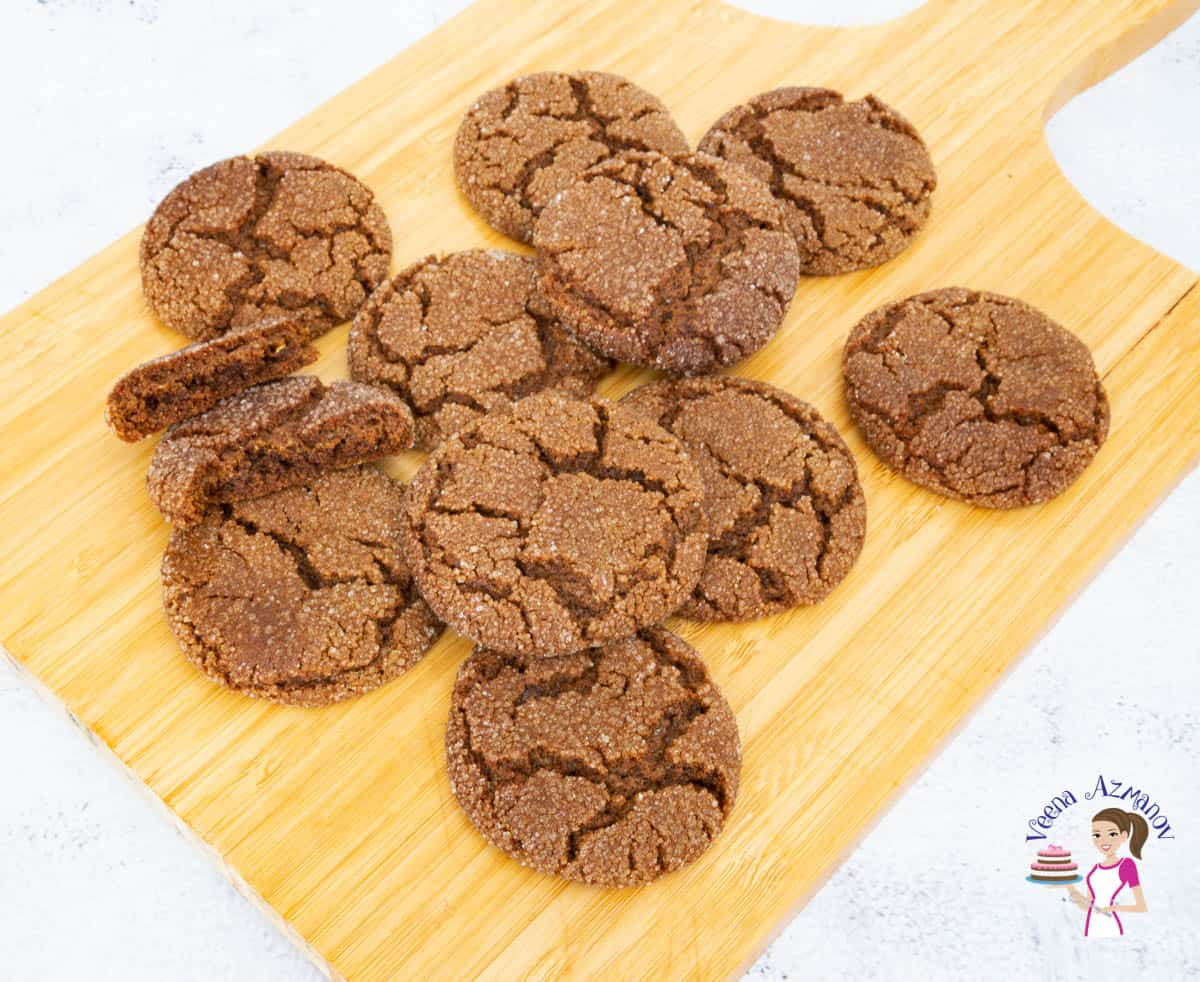 cookies scattered on a wooden board