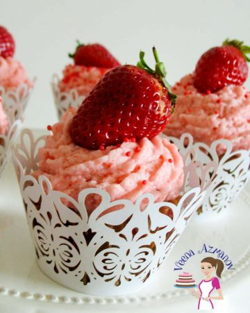 Cupcake with strawberry buttercream frosting.