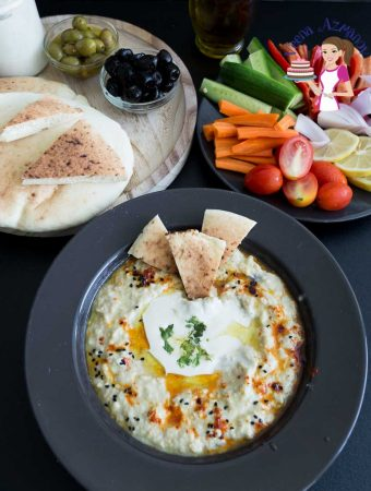 This simple but classic Middle Eastern dip Baba Ganoush is a Roasted Eggplant Dip often served as an appetizer or salad with pita bread