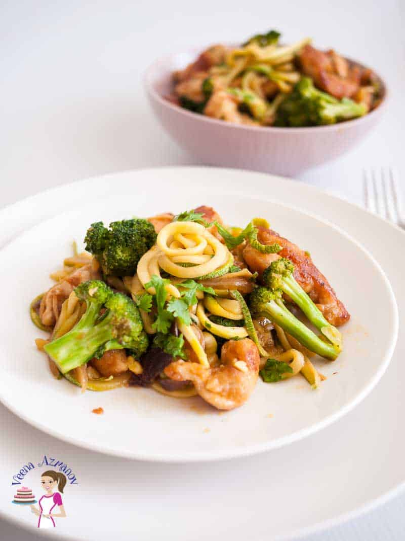 A quick simple and easy Asian recipe Broccoli and Chicken Zucchini noodles stir fry is low carb and get ready in less than 30 minutes.