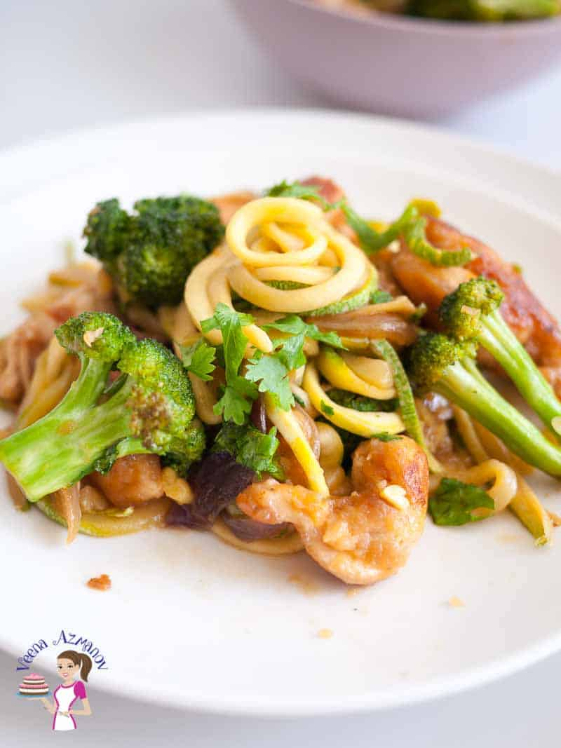 A plate of chicken with Broccoli and noodles.