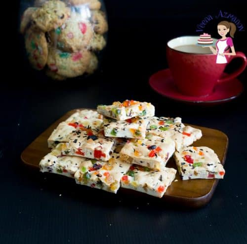 Candied fruit shortbread squares on a board.