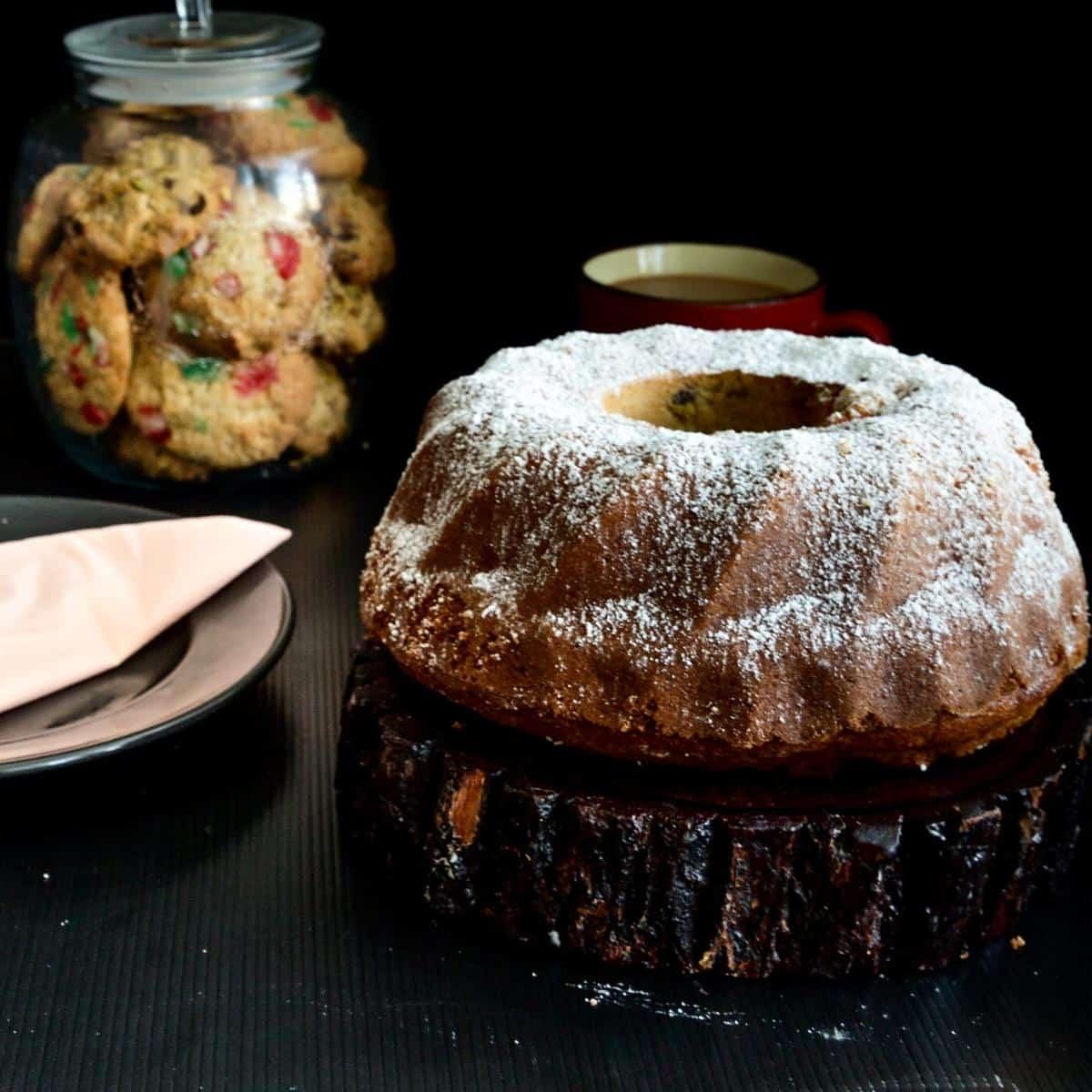 A bundt cake on a wooden board.