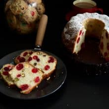 Slices of cherry cake on a black plate.