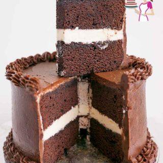 A sliced devils food chocolate cake.