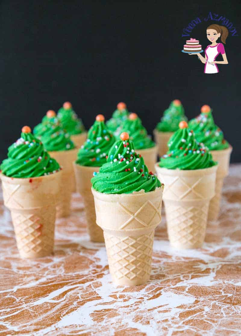 Cupcakes in ice cream cones with green frosting.