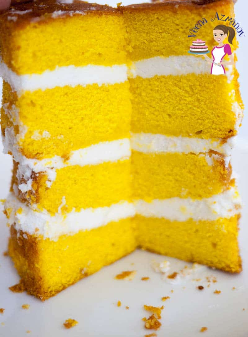 A close up of a slice of lemon cake decorated with lemon buttercream.