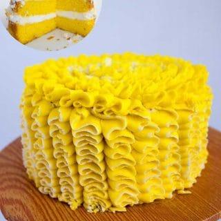 A lemon cake decorated with lemon buttercream.
