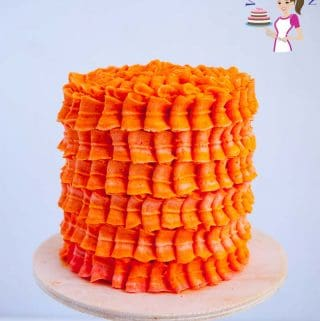 An orange layer cake with buttercream frosting.