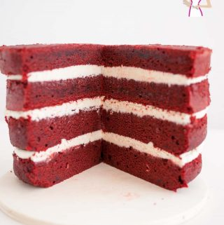 The best Red Velvet Cake Recipe frosted with Italian Meringue Buttercream Frosting is surprisingly easy to make in 10 minutes and bake in 25 minutes