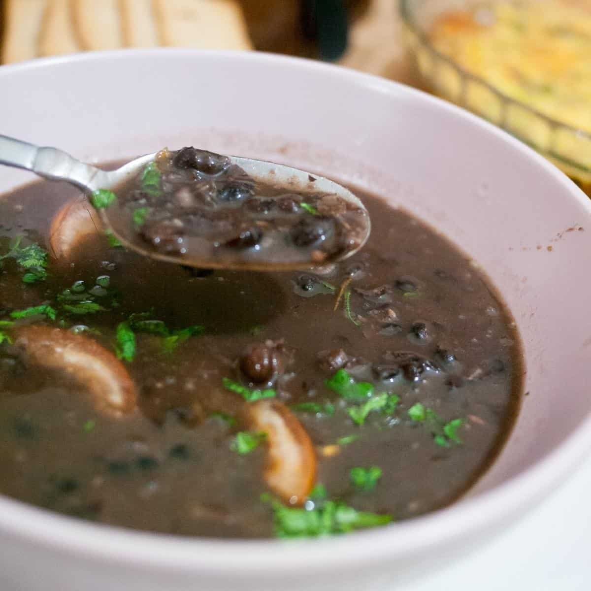 Black bean soup in a bowl with spoon