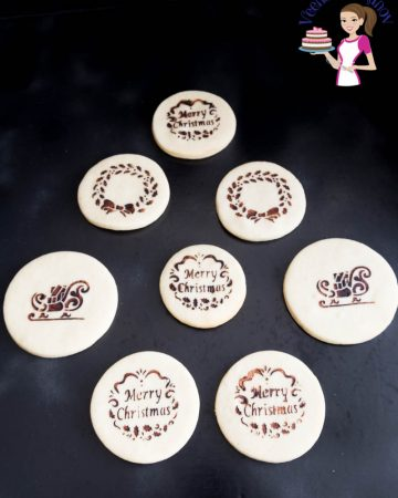 Stenciled sugar cookies on a table.
