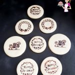 Stenciled Christmas sugar cookies on a table.