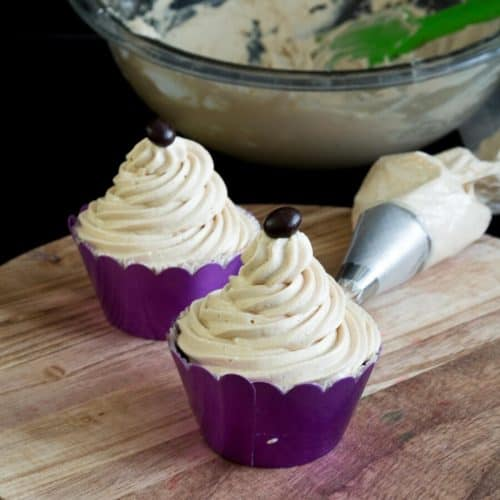Two frosted cupcakes with coffee buttercream