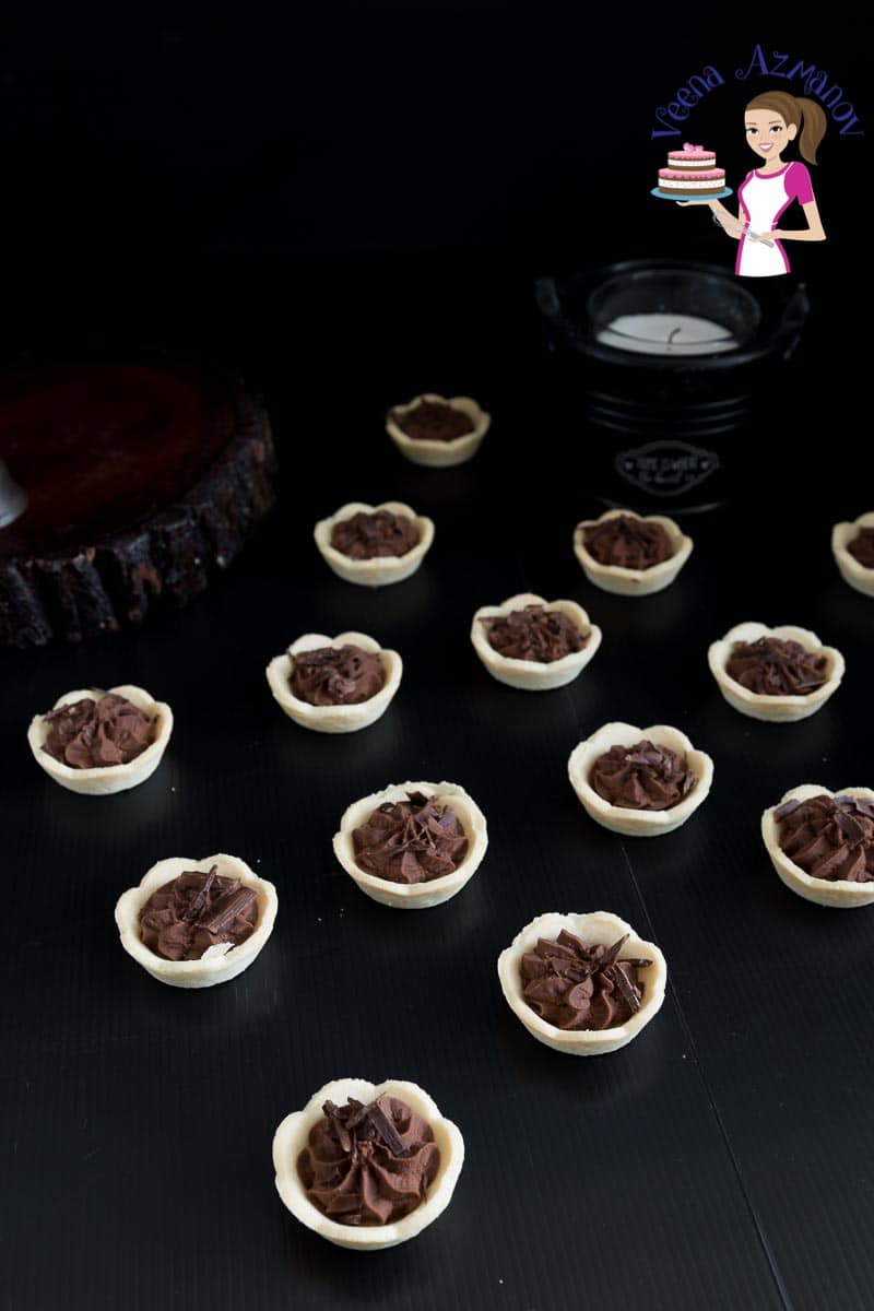 Mini chocolate mousse tarts on a table.