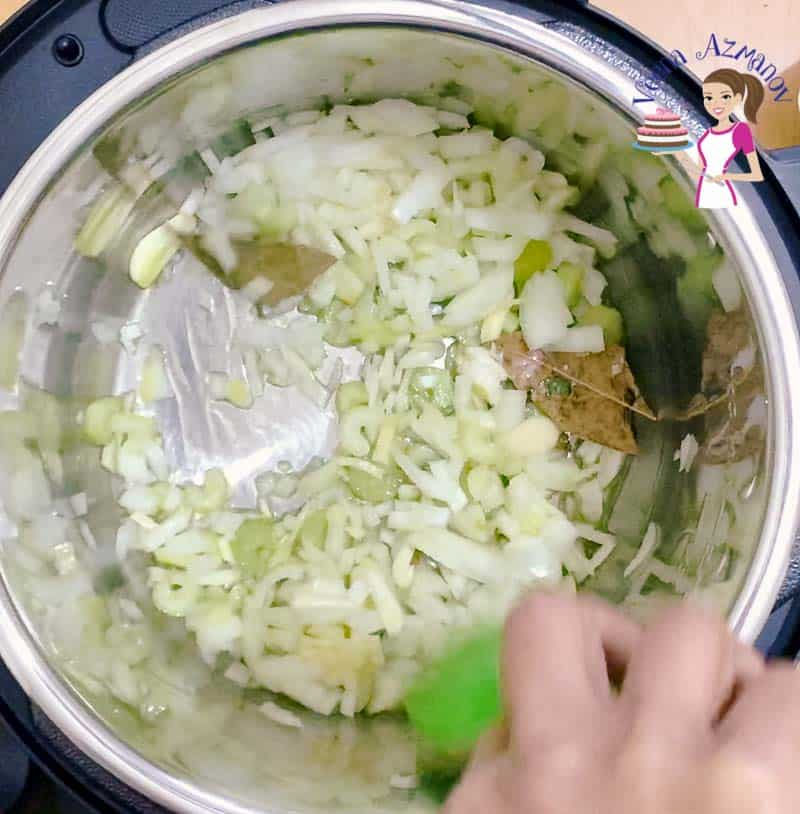 Onions being sautéed in an instant pot.