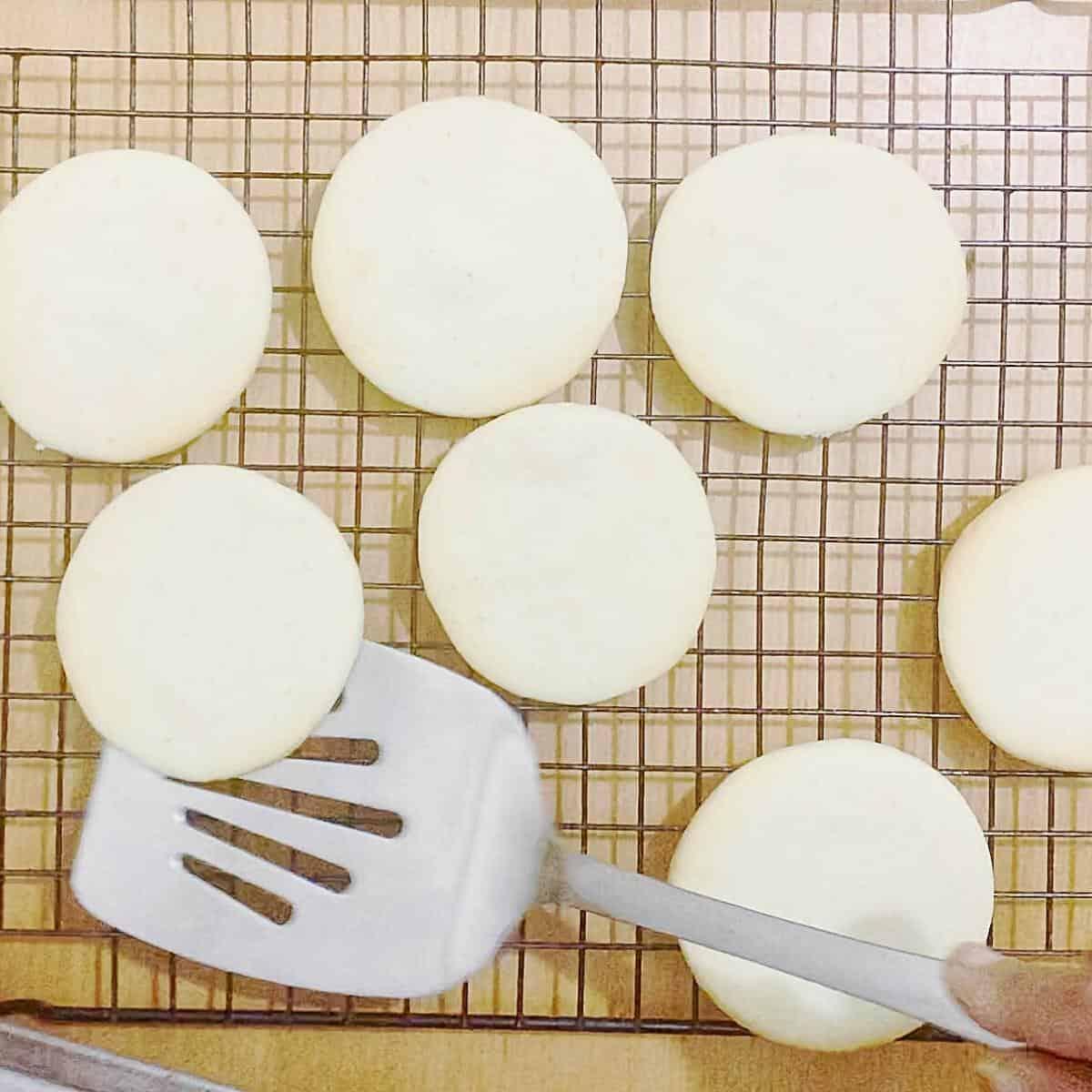 sugar cookies on a cooling rack.