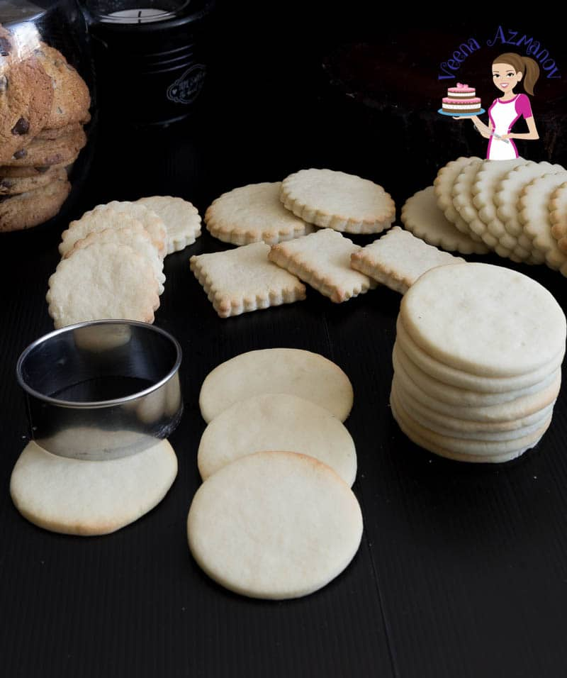 A stack of vanilla sugar cookies on a table.