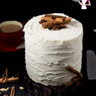 A gorgeous frosted Chai Latte Cake frosted with Vanilla Buttercream Frosting spiced with aromatic Indian chia spices like cinnamon, ginger and cardamom