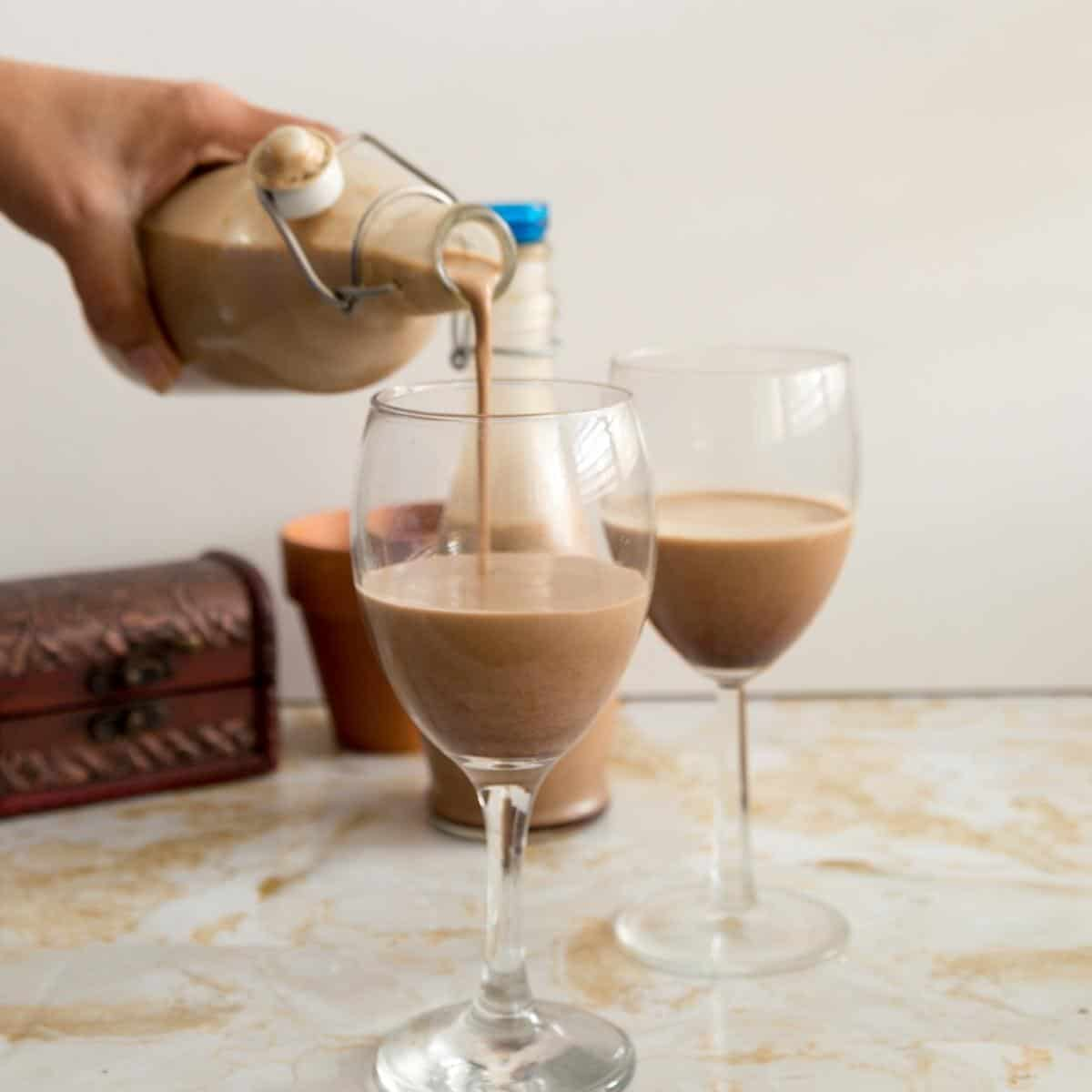 Pouring butterscotch Baileys in a wine glass