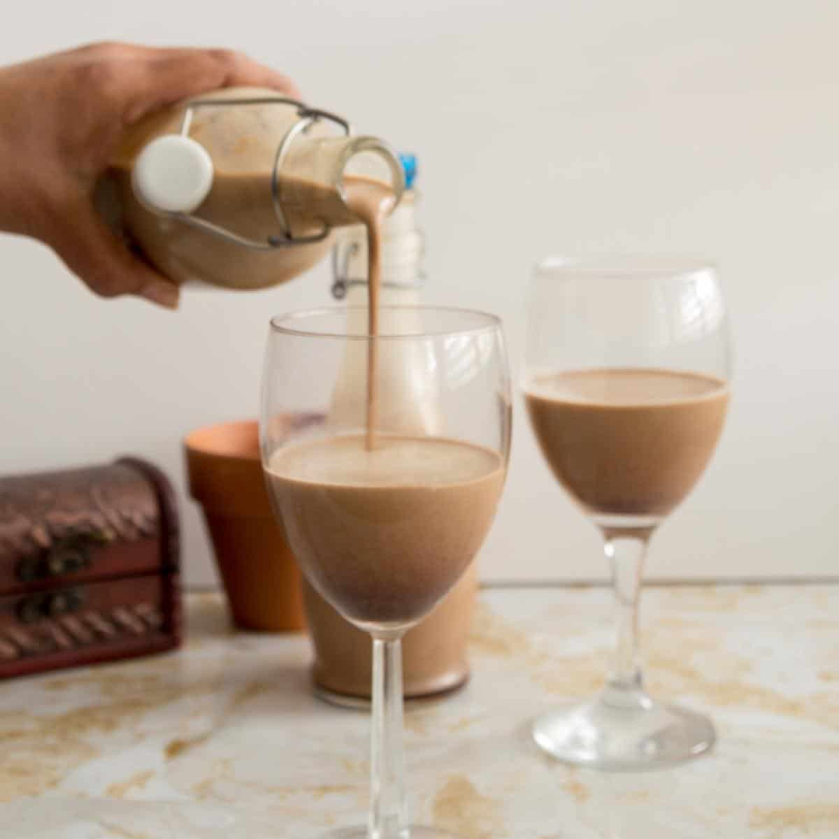 Pouring Irish cream in a wine glass